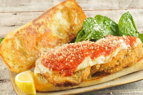 Eggplant Parmesan Sandwich with spinach-lemon salad Cooked and Plated