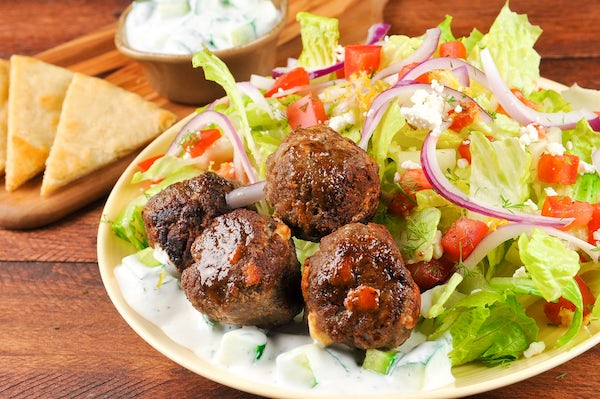 Turkey Gyro Meatball Salad with homemade tzatziki dressing and toasted pita chips Cooked and Plated