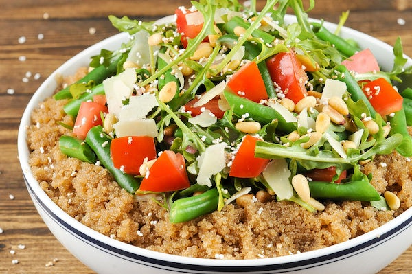 Amaranth Bowl with green beans, tomatoes, arugula, and Parmesan cheese Cooked and Plated