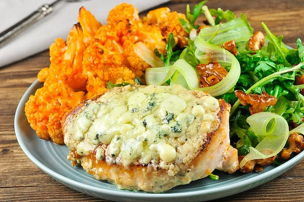 Flavors of Buffalo Bleu Cheese Chicken Breast with Buffalo cauliflower and arugula salad Cooked and Plated